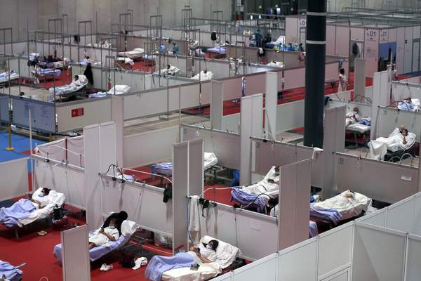 A view of a temporary field hospital set at Ifema convention and exhibition of in Madrid, Spain, Thursday, April 2, 2020. (AP Photo/Manu Fernandez)
