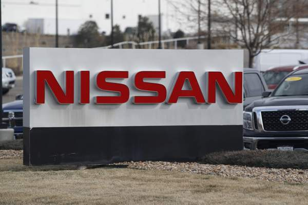 FILE - In this March 15, 2020, photograph, the company logo stands outside a Nissan dealership in Highlands Ranch, Colo. Nissan is recalling more than a quarter-million SUVs, trucks and vans worldwide, Thursday, April 2, to replace potentially dangerous Takata air bag inflators. The vehicles have air bags with volatile ammonium nitrate that can explode with too much force and hurl shrapnel. (AP Photo/David Zalubowski, File)