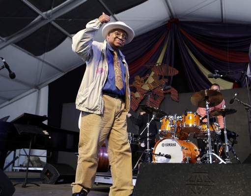 FILE - In this May 5, 2013, file photo, jazz pianist Ellis Marsalis, father of musicians Wynton Marsalis, Branford Marsalis, Delfeao Marsalis and Jason Marsalis, acknowledges the crowd after performing at the New Orleans Jazz and Heritage Festival in New Orleans. New Orleans Mayor LaToya Cantrell announced Wednesday, April 1, 2020, that Marsalis has died. He was 85. (AP Photo/Gerald Herbert, File)