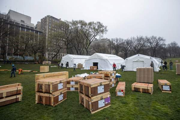 Associated Press A Samaritan's Purse crew works on building an emergency field hospital this week across from Mount Sinai Hospital in New York's Central Park.