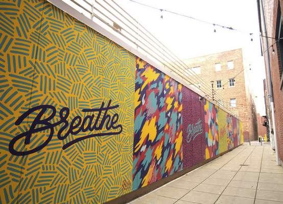 """Breathe"" is a mural created by Matthew Plett in the Midtowne Alley with alternating patterns of chaos and calm."
