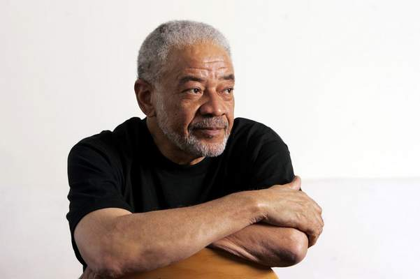 n this June 21, 2006 file photo, singer-songwriter Bill Withers poses in his office in Beverly Hills, Calif. (AP Photo/Reed Saxon, File)