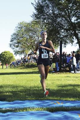 Katie Fyfe | The Journal Gazette Bishop Dwenger's Erin Strzelecki, the Indiana state champion, on Friday was named Miss Cross Country.