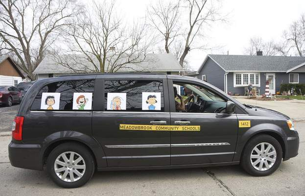 Katie Fyfe   The Journal Gazette  April Clifton turns her car into a Meadowbrook Community Schools bus for the Meadowbrook Pride Parade in New Haven on Saturday.