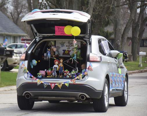 Katie Fyfe   The Journal Gazette  MeadowbrookNeighborhood Association President Stacey McDaniel, who organized the parade, decorated her car with a Toy Story theme on Saturday.