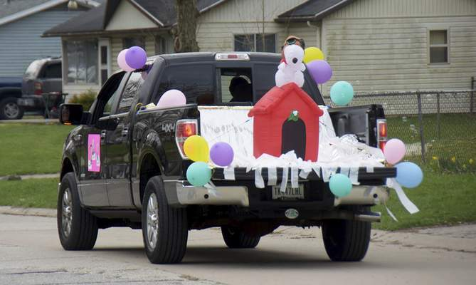 Katie Fyfe | The Journal Gazette  Sandy Bennett drives a Snoopy-themed truck during the Meadowbrook Pride Parade in New Haven on Saturday.