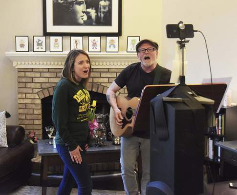 Katie Fyfe | The Journal Gazette  Abigail Noble and Joe Welch of Honey in the Sun perform for a Facebook livestream audience Sundayas part ofthe Fort Wayne Bar Aid effort to raise money for servers and bartenders in light of closures due to the coronavirus pandemic.