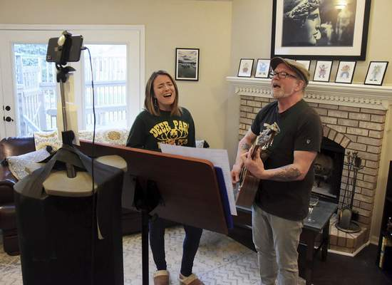 Katie Fyfe | The Journal Gazette  Abigail Noble and Joe Welch of Honey in the Sun perform for a Facebook livestream audience Sunday as part ofthe Fort Wayne Bar Aid effort to raise money for servers and bartenders in light of closures due to the coronavirus pandemic.