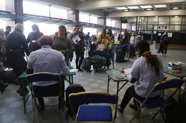 Stranded tourists from various countries register their names to get a rescue flight back to their country during lockdown in Kathmandu, Nepal, Saturday, April 4, 2020. (AP Photo/Niranjan Shrestha)