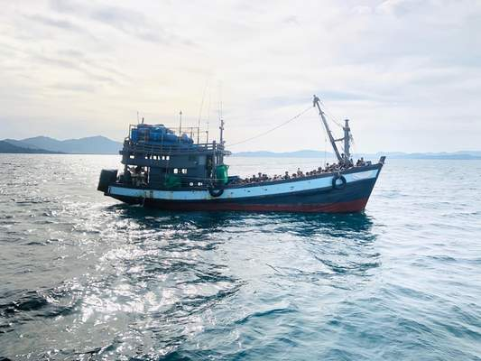 In this handout photo released on Sunday, April 5, 2020 by the Malaysian Maritime Enforcement Agency shows a wooden boat carrying suspected Rohingya migrants detained in Malaysian territorial waters off the island of Langkawi, Malaysia. (Malaysian Maritime Enforcement Agency via AP)