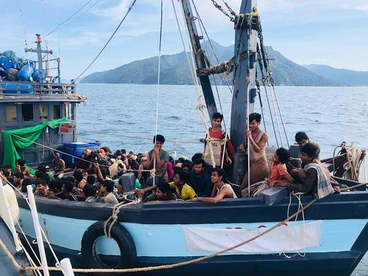 In this handout photo released on Sunday, April 5, 2020 by the Malaysian Maritime Enforcement Agency, a wooden boat carries suspected Rohingya migrants detained in Malaysian territorial waters off the island of Langkawi, Malaysia. (Malaysian Maritime Enforcement Agency via AP)