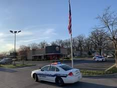 Ashley Sloboda| The Journal Gazette Police respond Sunday to a shooting at the Southgate Plaza Burger King. A man was taken to a hospital with non-life-threatening injuries.
