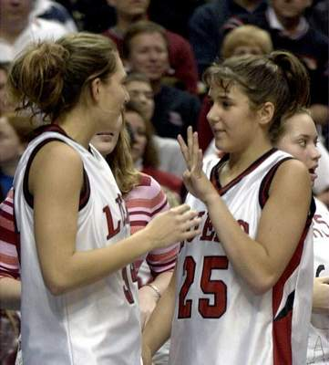 File Stephanie Gerardot, right, flashes a four signal to Megan Dossen after Bishop Luers won its fourth consecutive state championship in 2002.
