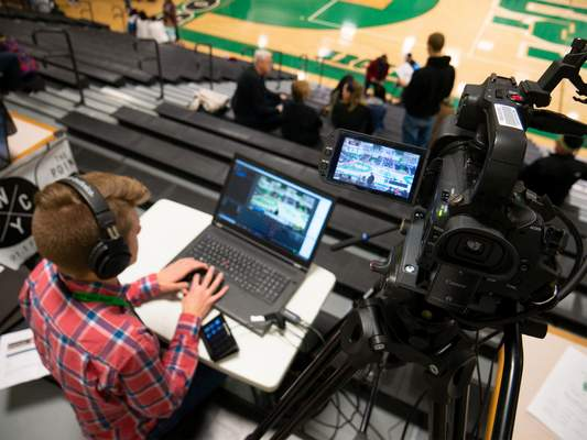 Courtesy Homestead High School junior Ashton Hackman covers the girls basketball Class 4A sectional at South Side High School. Hackman's broadcasting work resulted in Homestead winning the TV School of the Year Award last month.
