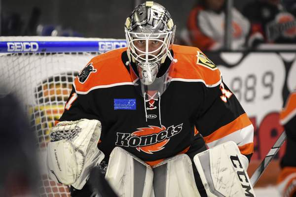 Mike Moore | The Journal Gazette  Komets goaltender Cole Kehler watches the puck against Kalamazoo at Memorial Coliseum.