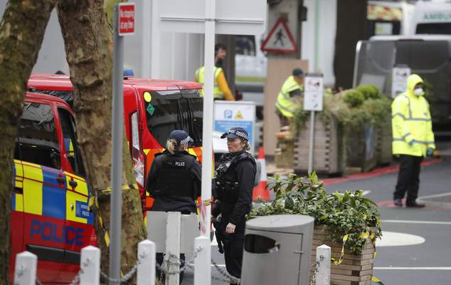 Police officers stand guard outside a hospital where it is believed that Britain's Prime Minister Boris Johnson is undergoing tests after suffering from coronavirus symptoms, in London, Monday, April 6, 2020. British Prime Minister Boris Johnson has been admitted to a hospital with the coronavirus. Johnson's office says he is being admitted for tests because he still has symptoms 10 days after testing positive for the virus. (AP Photo/Frank Augstein)