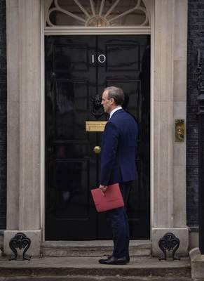 Britain's Foreign Secretary Dominic Raab arrives in Downing Street, London, Monday April 6, 2020, after Prime Minister Boris Johnson was admitted to a hospital for tests, 10 days after being diagnosed with the new coronavirus. Johnson's office said he was hospitalized Sunday because he still has symptoms, but it is not an emergency. (Dominic Lipinski/PA via AP)