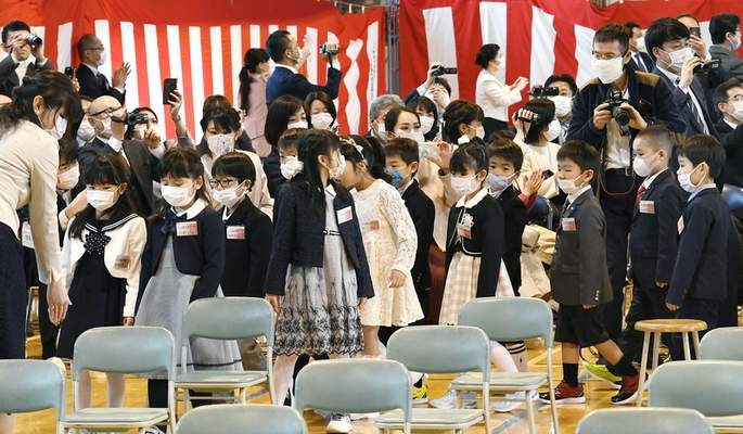 First-year pupils wearing face mask attend their entrance ceremony amid concern over the spread of coronavirus, at an elementary school in Sapporo, northern Japan, Monday, April 6, 2020. (Kyodo News via AP)