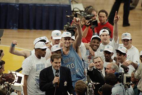 AP Was There North Carolina Michigan 1993 Basketba FILE - In this April 5, 1993, file photo, North Carolina coach Dean Smith at front center right, points as he celebrates a 77-71 win against Michigan in the NCAA Final Four championship basketball game in New Orleans. (AP Photo/Bob Jordan, File) (BOB JORDAN