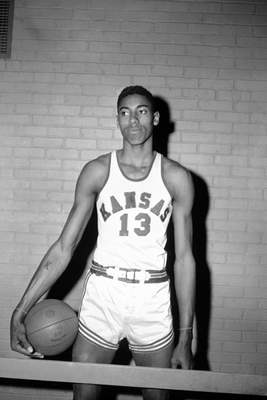 FILE - This is a March 1, 1957, file photo showing Kansas college basketball player Wilt Chamberlain posed in Allen Field House in Lawrence, Kan. UNC sure made things interesting to win its first NCAA title. (AP Photo/File)