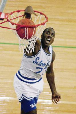 FILE - In this April 4, 1989, file photo, Seton Hall's John Morton slams home two of his 35 points against Michigan in the NCAA college basketball Final Four championship game in Seattle. Michigan defeated Seton Hall 80-79. (AP Photo/Gary Stewart, File)