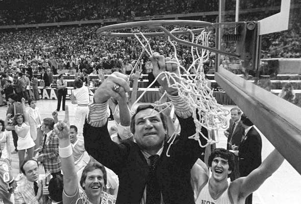FILE - In this March 29, 1982, file photo, North Carolina basketball coach Dean Smith cuts the net as happy players and fans cheer after the Tar Heels defeated Georgetown for the NCAA college basketball Final Four championship, in New Orleans. (AP Photo/Pete Leabo, File)