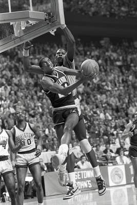 FILE - In this April 1, 1985, file photo, Villanova's Harold Pressley (21) goes up for a basket against Georgetown's Patrick Ewing in the NCAA college basketball Final Four championship game, in Lexington, Ky. (AP Photo/John Swart, File)