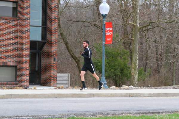 Grace Athletics  Soccer player Marcelo Talamas takes part in a relief run organized by the team at Grace.