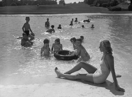 Aug. 10, 1947:Leisa Holzman guards the pool at the Fort Wayne Country Club while youngsters cool off in the water. (Journal Gazette file photo)