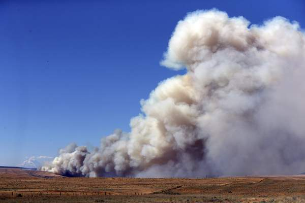 Associated Press  A fast-moving fire burns across northwest Oregon in July 2018. A study released Thursday says droughtconditions across much of the American West for the past two decades constitute an emerging  megadrought.