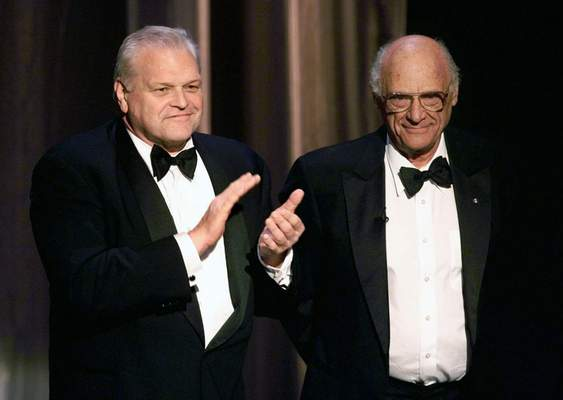 Associated Press Actor Brian Dennehy, left, applauds playwright Arthur Miller  at the Tony Awards in New York in 1999. Dennehy died at 81 Wednesday.