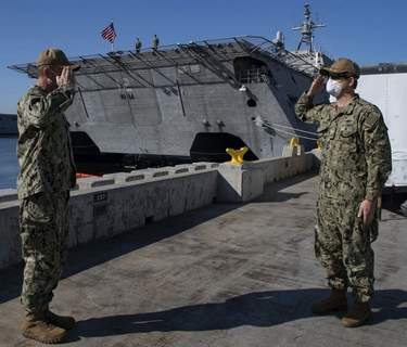 Crawford Courtesy U.S. Navy: Capt. Marc Crawford, right, a native of Fort Wayne, relieves Capt. Jack Fay, a native of Scarborough, Maine, as commanded, Surface Division ELEVEN, during a change of command ceremony in San Diego. Crawford is the second commander of the division.