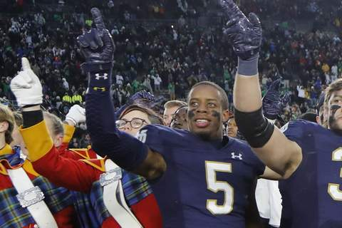 In a file photo from Nov. 2, 2019, Notre Dame cornerback Troy Pride Jr., (5) celebrates the team's victory over Virginia Tech in an NCAA college football game, in South Bend, Ind. (AP Photo/Carlos Osorio)