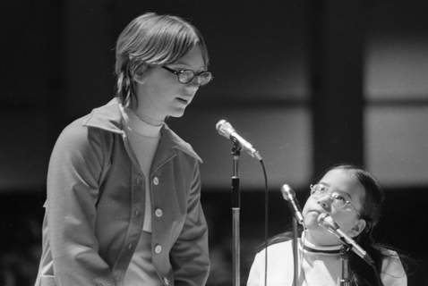 April 12, 1975:Molly Reddin, left, carefully spells the word missed by her rival, Carmen Donesa. She correctly spelled it and one more to become the champion of the Allen County Spelling Bee. (Journal Gazette file photo)