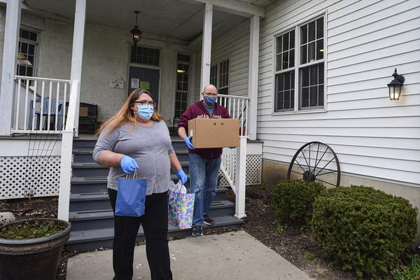 Care packages accompanied the food deliveries made Thursday by the Carriage House's Mary Rogers and Tom Weir.