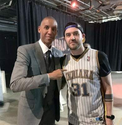 Courtesy photos Reggie Miller poses with Aaron Eamer, who has Miller's name and other Pacers' names tattooed on his right arm.