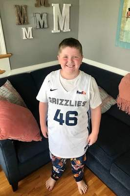 Archer Murphy, 9,was sent this  game-worn Memphis jersey used in the NBA Summer League by former Mastodon John Konchar.