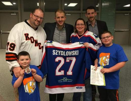 Courtesy  When Shawn Szydlowski scored five goals for the Komets on March 21, 2015, Robert Musser knew he had to have that jersey which was being auctioned for prostate cancer research. The bidding finally reached $2,000 before Musser could claim his prize.