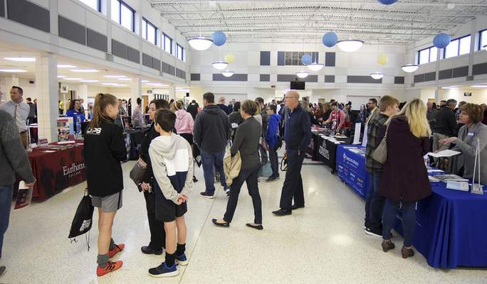 Katie Fyfe | The Journal Gazette The Homestead cafeteria fills with students and parents to get information during a college fair at Homestead High School on  March 9.