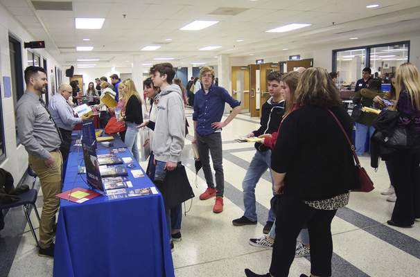 Katie Fyfe | The Journal Gazette  The Homestead cafeteria fills with students and parents to get information during the College Fair at Homestead High School on Monday, March 9th, 2020.