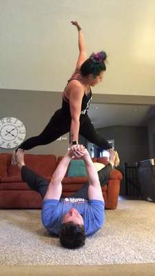 "Rebekka and Dave MarcAurele are part of ""The Family Yoga Challenge,""posting yoga poses on Facebook and challenging others to match it.""It's something fun that keeps us all together,"" Rebekka said.