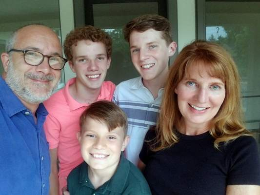 Courtesy When planning their divorce, Bill DeSalvo and Beth Behrendt opted for nesting as the best option for their three sons, Mick, Jack and Max.