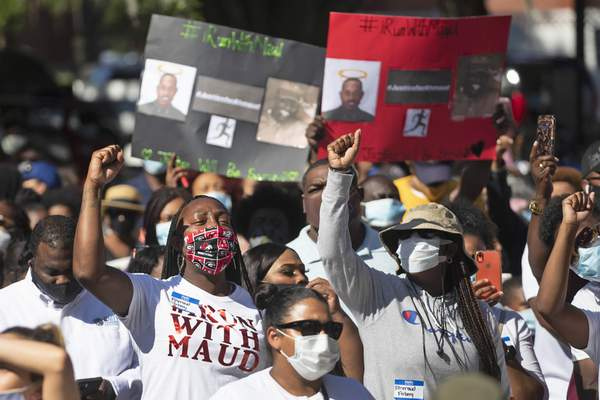People react during a rally to protest the shooting of an unarmed black man, Friday, May 8, 2020, in Brunswick Ga. (AP Photo/John Bazemore)