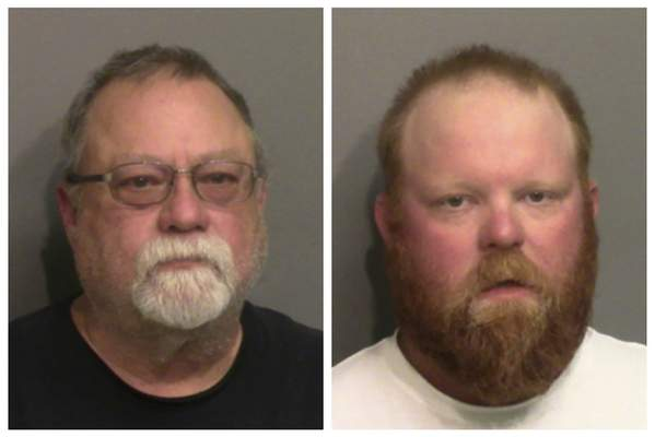 This photo combo of images taken Thursday, May 7, 2020, and provided by the Glynn County Detention Center, in Georgia, show Gregory McMichael, left, and his son Travis McMichael. The two have been charged with murder in the February shooting death of Ahmaud Arbery, whom they had pursued in a truck after spotting him running in their neighborhood. (Glynn County Detention Center via AP)