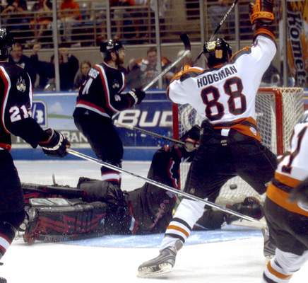 File Justin Hodgman  celebrates after scoring the winning goal in the third overtime of Game 7 of the 2008 IHL Turner Cup finals. The Komets rallied from a 3-games-to-1 deficit to win the championship.