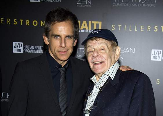 In this Feb. 11, 2011, photo, Ben Stiller, left, and his father Jerry Stiller arrive at the Help Haiti benefit honoring Sean Penn hosted by the Stiller Foundation and The J/P Haitian Relief Organization, in New York. (AP Photo/Charles Sykes, File)