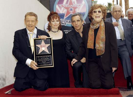 FILE - In this Feb. 9, 2007, file photo, actors Jerry Stiller, far left, and Anne Meara, second from right, pose with their children, Ben Stiller and Amy Stiller as they are honored with a star of the Hollywood Walk of Fame in Los Angeles. (AP Photo/Damian Dovarganes, File)