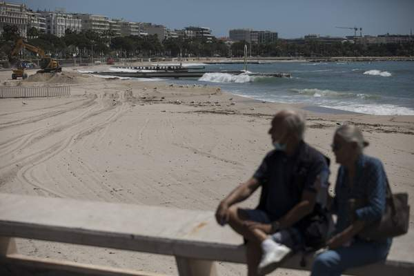 The deserted Croisette beach is pictured empty due to measures put in place to stop the spread of the coronavirus in Cannes, southern France, Tuesday, May 12, 2020. The Cannes Film Festival won't kick off as planned on Tuesday. The festival's 73rd edition has been postponed indefinitely, part of the worldwide shutdowns meant to stop the spread of the coronavirus. (AP Photo/Daniel Cole)