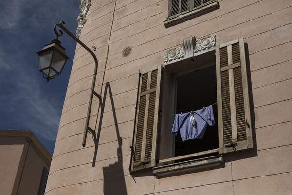 A mask dries in the sun together with a pair of pants in Cannes, southern France, Tuesday, May 12, 2020. The Cannes Film Festival won't kick off as planned on Tuesday. The festival's 73rd edition has been postponed indefinitely, part of the worldwide shutdowns meant to stop the spread of the coronavirus. (AP Photo/Daniel Cole)