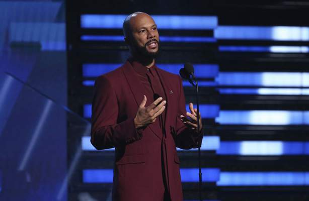 FILE - In this Jan. 26, 2020 file photo, Common introduces a performance at the 62nd annual Grammy Awards in Los Angeles. (Photo by Matt Sayles/Invision/AP, File)